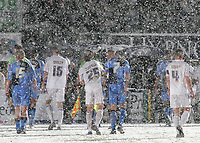 Macclesfield's Terry Dunfield playfully throws a snowball in the direction of the match officials as the players leave the field of play after the match was abandoned during Wycombe Wanderers vs Macclesfield Town, Coca Cola League Division Two Football at Adams Park on 28th October 2008