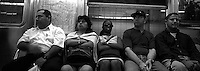 Crowded bench on the subway. Subway series shot in New York between the years 1998 and 2001