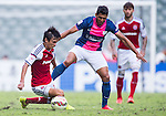 Wai Ho Chan of SCAA (L) competes for the ball with Robson Augusto Ka Hai of Kitchee (R) during the HKFA Premier League between South China Athletic Association vs Kitchee at the Hong Kong Stadium on 23 November 2014 in Hong Kong, China. Photo by Aitor Alcalde / Power Sport Images