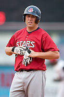 Huntsville first baseman Brad Nelson removes his batting gloves after making the third out in the top of the first inning versus Carolina at Five County Stadium in Zebulon, NC, Wednesday, July 19, 2006.