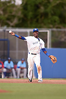 Dunedin Blue Jays third baseman Gustavo Pierre (17) throws to first during a game against the Daytona Cubs on April 14, 2014 at Florida Auto Exchange Stadium in Dunedin, Florida.  Dunedin defeated Daytona 1-0  (Mike Janes/Four Seam Images)