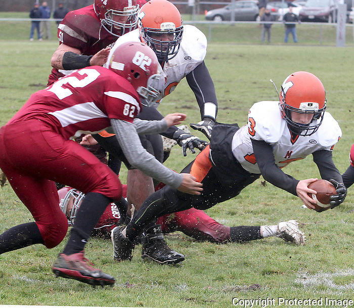 Middleboro quarterback Brendan Chipman finds the end zone in the first quarter against Carver on Thursday, Nov. 27, 2014, at Carver High School.