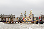 Greenwich, London, UK. 7 September 2014. The Royal row barge Gloriana at the Royal Naval College in Greenwich with tall ships at the back. Her Majesty the Queen's row barge Gloriana leads a  Royal Pageant up the River Thames from Martime Greenwich during the Tall Ships Festival, Greenwich, London, UK. Photo: Bettina Strenske