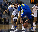 San Jose State guard Seneca Knight (23) dribbles the ball between his legs as he is guarded by Nevada's Cody Martin (11) in the second half of an NCAA college basketball game in Reno, Nev., Wednesday, Jan. 9, 2019. (AP Photo/Tom R. Smedes)