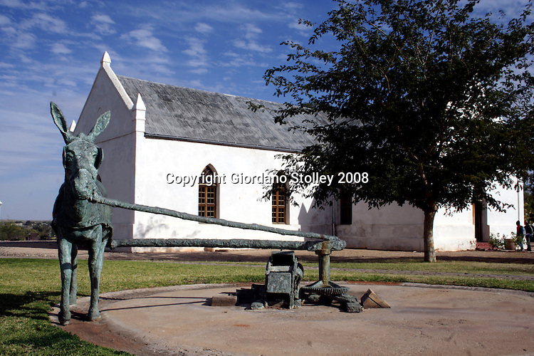 UPINGTON, NORTHERN CAPE - 17 June 2008 - Standing  frozen in bronze  in front of the Kalahari-Oranje Museum in Upington in the Northern Cape is the figure of a donkey harnessed to a crushing mill. This donkey memorial is dedicated to the many beasts that worked  and died  during the early days of the Lower Orange River Valley development..Picture: Giordano Stolley/Allied Picture Press/APP