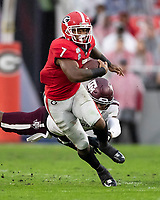ATHENS, GA - NOVEMBER 23: D'Andre Swift #7 of the Georgia Bulldogs evades a tackle during a game between Texas A