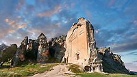 The Phrygian rock Monument known locally as Yazilikaya, ( written rock ) . 8th - 6th century BC . Midas City, Yazilikaya, Eskisehir, Turkey.<br /> <br /> This is the largest Phrygian rock cut facade monument, measuring 17m x 16.5m. It represents the front of a Phrygian megaron type building with a low pitched roof. It is known locally as yazilikaya , which means &ldquo;written rock&rdquo;, because of the Paleo-Phrygian inscriptions carved above the rock above the roof outline, down the right side and in the niche. The upper inscription dedicates the monument to King Midas, and so it is also known as the &ldquo;Midas Monument&rdquo;. The niche probably contained an image of the Phrygian Mother  Goddess, and the word &ldquo;Matar&rdquo; (Mother) is inscribed inside. The monument was carved  around the 8th and  6th century BC.
