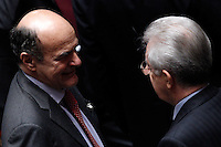 Il leader del Partito Democratico Pierluigi Bersani, a sinistra, parla col Presidente del Consiglio Mario Monti dopo aver votato, alla seduta comune di senatori e deputati per l'elezione del nuovo Capo dello Stato alla Camera dei Deputati, Roma, 18 aprile 2013..Italian Democratic Party's leader Pierluigi Bersani, left, talks toPremier Mario Monti after voting in a common plenary session of senators and deputies to elect the new Head of State, at the Lower Chamber in Rome, 18 April 2013..UPDATE IMAGES PRESS/Riccardo De Luca.