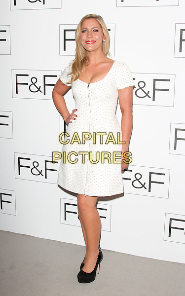 Heidi Range.F&F autumn/winter 2013 collection showcase at Somerset House, London, May 16th 2013..full length white dress hand on hip zip black shoes polka dot .CAP/ROS.©Steve Ross/Capital Pictures.