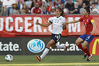 USWNT forward Alex Morgan (13) dribbles as Korea Republic defender Shim Seoyeon (4) defends. In an international friendly, the U.S. Women's National Team (USWNT) (white/blue) defeated Korea Republic (South Korea) (red/blue), 4-1, at Gillette Stadium on June 15, 2013.