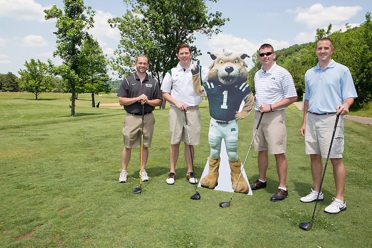 Left to right: Wes Bonadio, Ryan Lombardi, Mark Ferguson, and Nick Olesky at the alumni golf outing. Photo by Lauren Pond