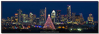 The Zilker Park Christmas Tree and the annual Trail of lights shines against a backdrop of the Austin Skyline. In the distance are the Austonion and the Frost Bank Tower, two icons of Austin.