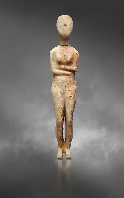 Marble female Cycladic statue figurine with folded arms of the Spedos type. Early Cycladic Period II (2800-2300 BC) from Stavros cemetery, Amorgos, grave 5, Cat No 4719. National Archaeological Museum, Athens.   Gray background.<br /> <br /> <br /> This Cycladic statue figurine is of the Spedos type standing on tip tie with bended knees and arms folded under the breasts with head raiised.