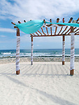 Decorated trellis on beach at Caribbean resort