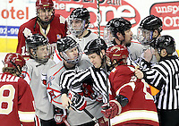 Officials work to separate UNO and Denver players during the first period. Denver beat Nebraska-Omaha 4-2 Saturday night at Qwest Center Omaha. (Photo by Michelle Bishop)