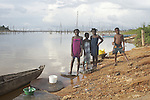 Children on the shore of the Brokopondo reservoir in the village of Lebidoti, Suriname.  The man-made lake was hastily created by flooding a vast acreage of jungle without any prior logging and evacuation of animals and is reputed to be polluted by mercury from unregulated gold mining..