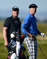Ex Cricketers Shane Warne (L) and Michael Vaughan look on during Round 1 of the 2015 Alfred Dunhill Links Championship at the Old Course, St Andrews, in Fife, Scotland on 1/10/15.<br /> Picture: Richard Martin-Roberts | Golffile