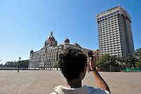 A man takes a photograph of the Taj Mahal and Tower on the 2nd of December 2008, Mumbai, India.