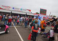 Jun 5, 2015; Englishtown, NJ, USA; Fans wait in line for some time with their favorite Toyota drives in the NHRA Toyota display during qualifying for the Summernationals at Old Bridge Township Raceway Park. Mandatory Credit: Mark J. Rebilas-