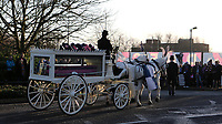 Fans of Dulwich Hamlet and other clubs line the street outside DHFC to pay their respects to Mishi as the horse and carriage arrives. Mourners were asked to wear their pink and blue Dulwich Hamlet kit or other football kit during the funeral of Dulwich Hamlet FC supporter Mishi Morath at Champion Hill Stadium on 15th January 2020