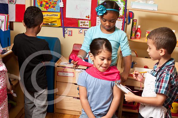 Education Preschool Headstart pretend play boy taking food order from girl having haircut