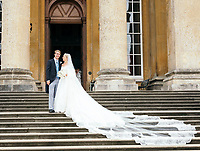BNPS.co.uk (01202 558833)<br /> Pic: BlenheimPalace<br /> <br /> Lord and Lady Blandford on their wedding day last year.<br /> <br /> The stunning wedding dress worn by Camilla Thorp on her marriage to Lord George Blandford, heir to the Duke of Marlborough, has just gone on display at Blenheim Palace in Oxfordshire.<br /> <br /> The first bespoke Dolce & Gabbana bridal gown ever to have been worn in Britain, Lady Blandford made several visits to the Milan fashion house prior to her lavish September wedding last year.<br /> <br /> The dress, which is on display in the Palace's Long Library, features an off-the-shoulder lace bodice with tiny, pale pink and white appliqued flowers and seed pearls. <br /><br />The skirt is made up of layers of tulle for volume and topped with organza. Lace is also featured on the hem of the skirt and around the edge of the silk tulle veil.