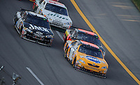 Oct 5, 2008; Talladega, AL, USA; NASCAR Sprint Cup Series driver Kyle Busch (18) leads the field during the Amp Energy 500 at the Talladega Superspeedway. Mandatory Credit: Mark J. Rebilas-