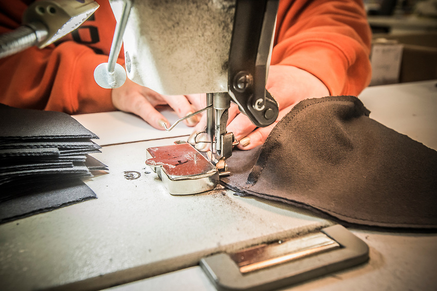 Third step in the Stormy Kromer manufacturing process sewing the hat lining at the Ironwood, Michigan production facility.