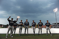 Members of the visiting Rome Braves entertained the crowd during a lengthy rain delay before a game against the Greenville Drive on July 5, 2012, at Fluor Field at the West End in Greenville, South Carolina. The game eventually was postponed due to rain. (Tom Priddy/Four Seam Images)