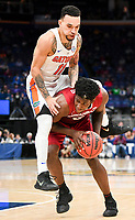 NWA Democrat-Gazette/CHARLIE KAIJO Florida Gators guard Chris Chiozza (11) fouls Arkansas Razorbacks guard Jaylen Barford (0) during the Southeastern Conference Men's Basketball Tournament quarterfinals, Friday, March 9, 2018 at Scottrade Center in St. Louis, Mo.