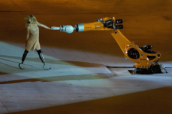RIO DE JANEIRO - 7/9/2016:  Amy Purdy carries dances with a KUKA robotics arm during the Opening Ceremonies in Maracana at the Rio 2016 Paralympic Games. (Photo by Matthew Murnaghan/Canadian Paralympic Committee