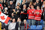 Prime Minister Stephen Harper cheers on Team Canada during sledge hockey action in Vancouver during the 2010 Paralympic Games. Credit: CPC/HC/Matthew Manor.