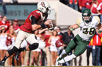 Oklahoma quarterback Trevor Knight (9) attempts to run past Baylor nickelback Collin Brence (38) during NCAA football game, Saturday, November 08, 2014 in Norman, Tex. Baylor defeated Oklahoma 48-14. (Mo Khursheed/TFV Media via AP Images)
