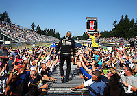 Aug. 3, 2014; Kent, WA, USA; NHRA top fuel dragster driver Tony Schumacher greets fans during driver introductions prior to the Northwest Nationals at Pacific Raceways. Mandatory Credit: Mark J. Rebilas-USA TODAY Sports