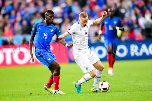 03.07.2016. St Denis, Paris, France. UEFA EURO 2016 quarter final match between France and Iceland at the Stade de France in Saint-Denis, France, 03 July 2016. Paul Pogba (France) vbeaten by Kolbeinn Sigthorsson (Ice)