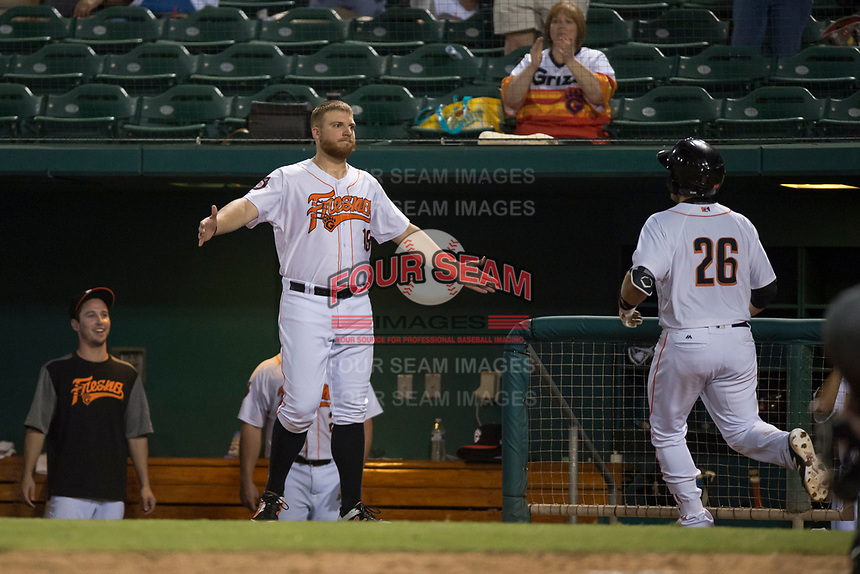 Fresno Grizzlies first baseman AJ Reed (18) congratulates Tim Federowicz (not pictured) after scoring a run during a Pacific Coast League game against the Salt Lake Bees at Chukchansi Park on May 14, 2018 in Fresno, California. Fresno defeated Salt Lake 4-3. (Zachary Lucy/Four Seam Images)