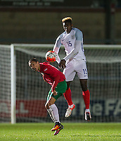 Darnell Johnson (Leicester City) of England U19 & Angel Lyaskov (CSKA) of Bulgaria U19 go up for the ball during the International friendly match between England U19 and Bulgaria U19 at Adams Park, High Wycombe, England on 10 October 2016. Photo by Andy Rowland.