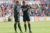 Referee Robert Jones (R) speaks to Neil Etheridge of Cardiff City during the Sky Bet Championship match between Swansea City and Cardiff City at the Liberty Stadium, Swansea, Wales, UK. Sunday 27 October 2019