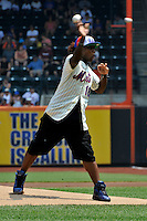 Actor/ singer Leon Thomas throws out the first pitch prior to game between the St. Louis Cardinals and the New York Mets at Citi Field on July 21, 2011 in Queens, NY.  Cardinals defeated Mets 6-2.  Tomasso DeRosa/Four Seam Images