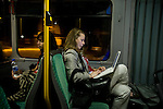 Zoe Caron, Canadian Negotiator tracker and youth member continues her work late at night on the trip back to the hostel. United Nations Climate Talks in Bonn Germany (©Robert vanWaarden)