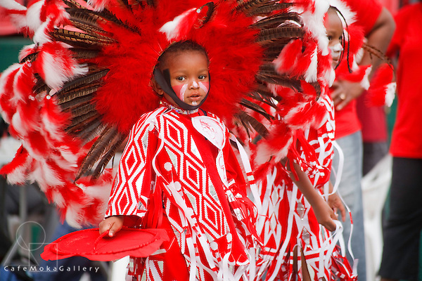 Trinidad Carnival, Junior Carnival, young boy playing fancy indian in red and white