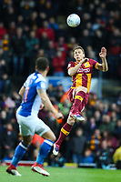 Stephen Warnock of Bradford City heads the ball forward during the Sky Bet League 1 match between Blackburn Rovers and Bradford City at Ewood Park, Blackburn, England on 29 March 2018. Photo by Thomas Gadd.