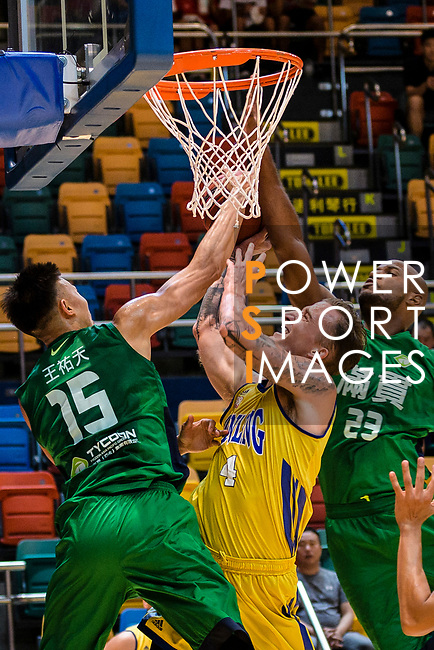 Bullen Christian Matthew #4 of Winling Basketball Club goes to the basket against the Tycoon during the Hong Kong Basketball League playoff game between Winling and Tycoon at Queen Elizabeth Stadium on July 24, 2018 in Hong Kong. Photo by Marcio Rodrigo Machado / Power Sport Images