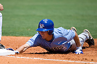 Memphis Tigers second baseman Chad Zurcher #2 dives back to first against the Rice Owls in NCAA Conference USA baseball on May 14, 2011 at Reckling Park in Houston, Texas. (Photo by Andrew Woolley / Four Seam Images)