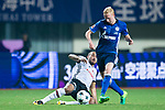 Besiktas Istambul Forward Cenk Tosun (L) trips up with FC Schalke Midfielder Luke Hemmerich (R) during the Friendly Football Matches Summer 2017 between FC Schalke 04 Vs Besiktas Istanbul at Zhuhai Sport Center Stadium on July 19, 2017 in Zhuhai, China. Photo by Marcio Rodrigo Machado / Power Sport Images