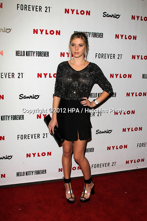 LOS ANGELES - OCT 15:  Claire Julian arrives at  Nylon's October IT Issue party at London West Hollywood on October 15, 2012 in Los Angeles, CA
