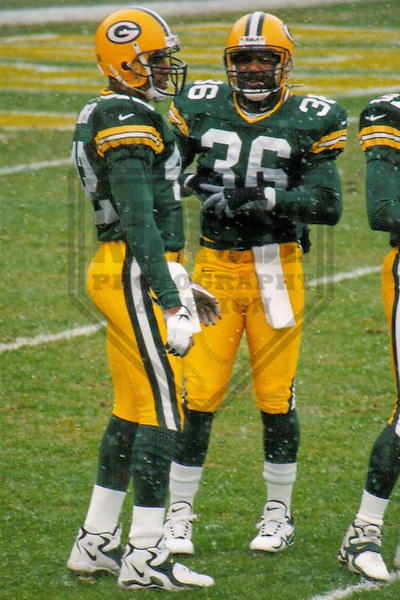 GREEN BAY - DECEMBER 1998: Darren Sharper (42) and LeRoy Butler (36) of the Green Bay Packers warm up prior to a game on December 20, 1998 at Lambeau Field in Green Bay, Wisconsin. (Photo by Brad Krause)