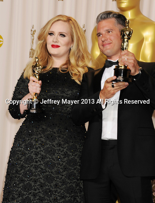 HOLLYWOOD, CA - FEBRUARY 24: Adele and Paul Epworth pose in the press room the 85th Annual Academy Awards at Dolby Theatre on February 24, 2013 in Hollywood, California.