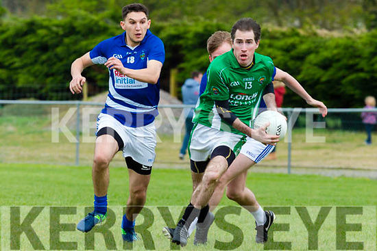 Cathal Moriarty Milltown/Castlemaine breaks away from Laune Ramgers defenders Ryan Keane and Aidan Cox during their Intermediate clash in Milltown on Sunday