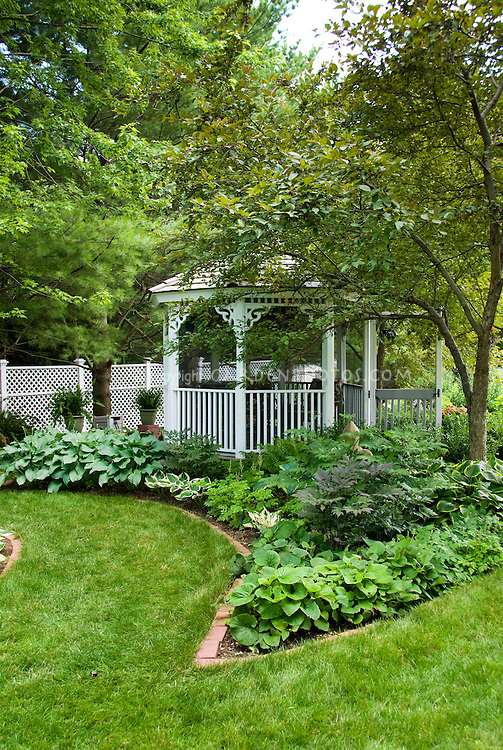 Gazebo Shade garden lawn grass neatly edged beds in brick